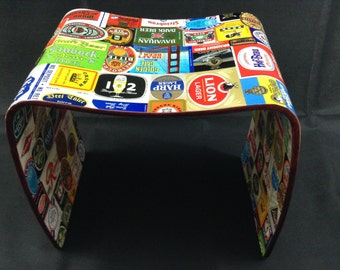 Stool or side table covered in Original Beer Labels from around the world. Great for living area, man cave or games room