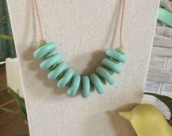 Pale aqua blue and green bead necklace