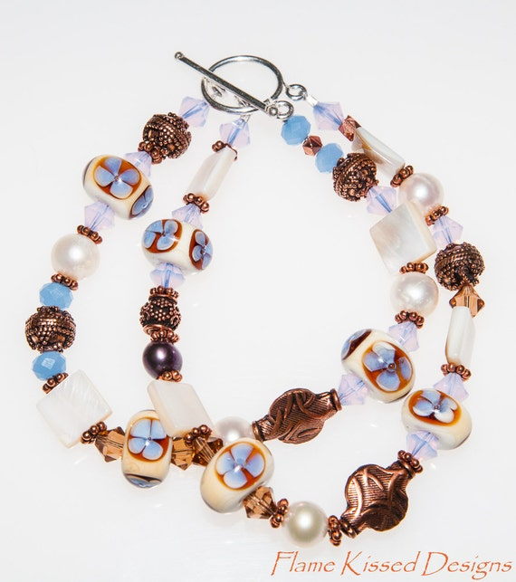FORGET-ME-NOT. A double strand handcrafted lampwork bead bracelet.