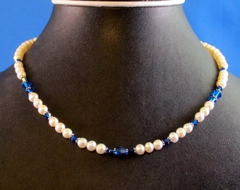 White pearl and Capri Blue Swarovski crystal necklace with silver plated accents and toggle clasp