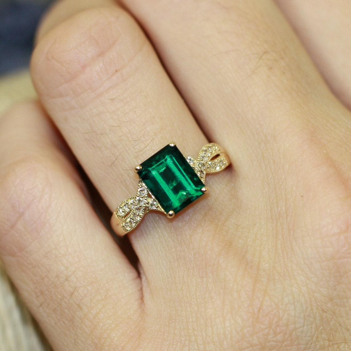solitaire emerald engagement ring in 10k yellow gold infinity