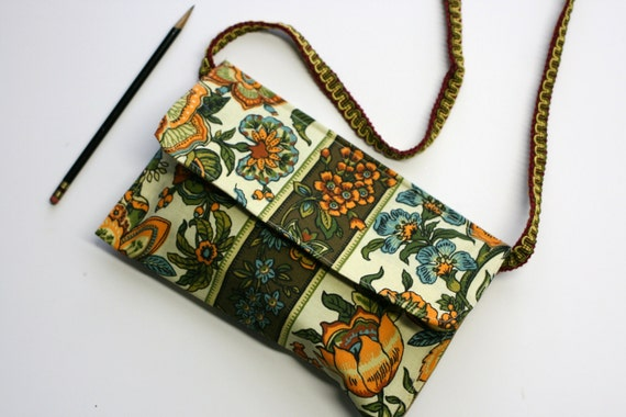 Orange blue floral with brown stripe flap over purse
