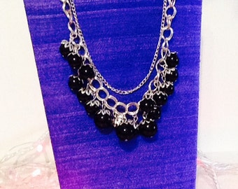 Silver chain with black beads