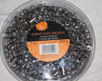 This is a new unopened 200 grams of charms or beads for making things