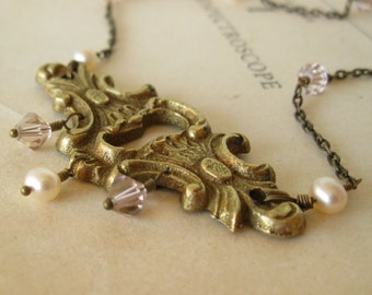 Antique Brass Keyhole necklace with swarovski crystals and freshwater pearls