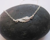 Sideways wing sterling silver charm necklace