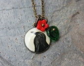 Retro raven necklace - crow picture charm, red glass flower, emerald green glass leaf, antiqued brass chain - free shipping USA