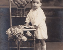 Vintage Real Photo Postcard - Little Boy Posing with Book - Ornate Chair and Roses