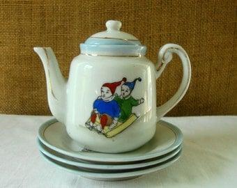 VINTAGE PORCELAIN CHILD Set Teapot and 3 Plates Winter Children Sleding 5 Piece Vintage Set Lusterware