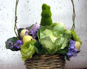 Easter bunny entry centerpiece basket with cabbages, eggs, flowers for springtime parties, Easter egg hunt decoration, pastel speckled eggs