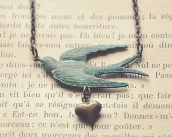 swooping swallow necklace.