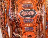 Beautiful orange 1970's dress with smocking