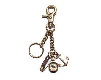 Keychain for men with belt hook carabiner in brass with functional mini compass, miniature knife and anchor pendant.