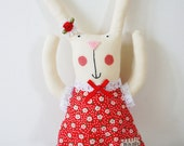 Personalised Animal Art Doll with red floral dress and bow.