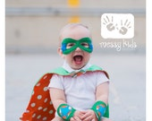Thwack Custom Superhero Cape Infant Size Includes Mask and Cuffs Set in Aqua Blue, Red, Green, Pink or Orange by Messy Kids Designs