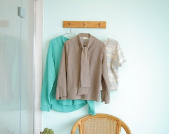 Vintage lined beige and marine blue blouse with a bow or a tie