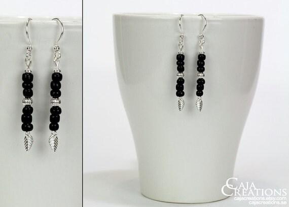 https://www.etsy.com/se-en/listing/175521300/black-ooak-earrings-with-leaves