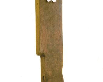 Wooden clock made from a reclaimed oak beam.