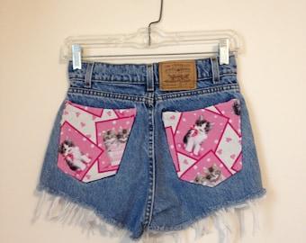 High waist denim ripped shorts with cat print pockets