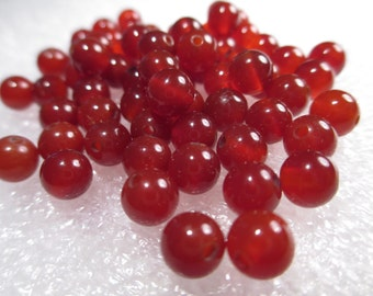 CARNELIAN rounds, 5mm - 6mm - lot of 11
