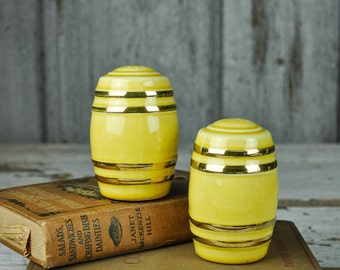 Yellow Salt and Pepper Shakers with Gold Trim