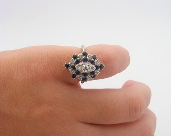 1.00 Carat Total Gem Weight Blue Sapphire and Diamond Cluster Ring. 14K White Gold. SI1 - G
