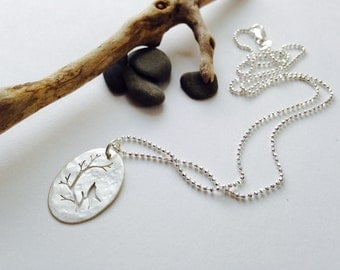 Sterling Silver Bird Necklace. Hand cut  Bird silhouette in Oval Pendant