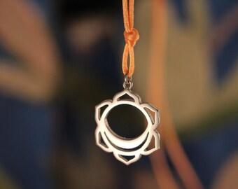 chakra necklace, chakra pendant, silver, with the svadhisthana chakra sex chakra and orange  cord or chain.