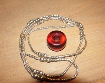 Channel type necklace made of antique handmade silver Jimma beads, and ressin  bead ofEthiopia