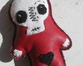 red Death Skull faced doll skelly