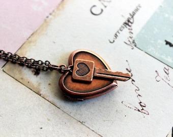 heart key. locket necklace. in copper ox jewelry