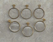 6 Optical lenses. Gold or Brass colored.. beautiful..