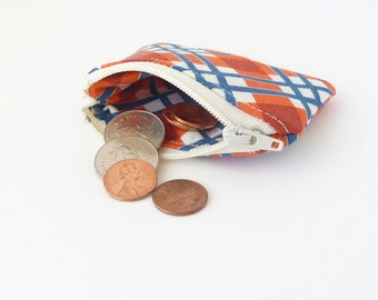 earbud case. tiny cute zipper pouch. orange navy plaid fabric hearing aid safety pin pill small pouch. jewelry case travel. lobster claw