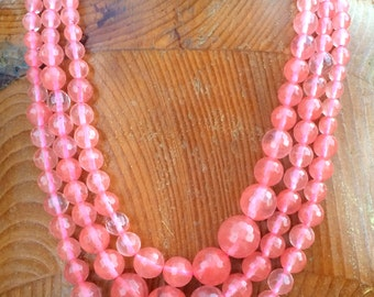 """Watermelon Stone Faceted Round Beads, a graduated 17 1/2"""" strand."""