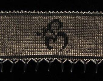 """Titled: """"Om"""" woven cuff loom bracelet."""