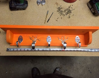 Personalized Spoon Hooks and Funky Fork Hooks on an Orange Stained Shelf
