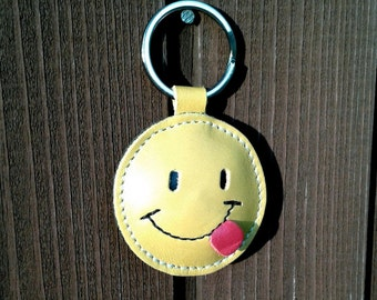 Smiley tongue sticking out, cheeky/playful, blowing a raspberry / Happy Face Yellow Leather Keychain FREE Shipping