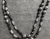 "Vintage Long 54"" Flapper Necklace Black and Silver Textured and Faceted Plastic Beads Amazing Detail!"