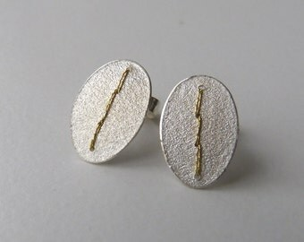 Silver oval disc earrings studs stitched with gold thread