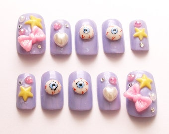 Pastel goth, lilac, deco nails, Harajuku, creepy kawaii, 3D nails, star, bows, Japanese fashion, eyeballs, kyary, lolita accessory