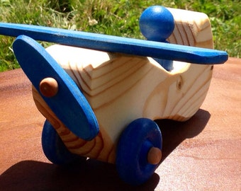 Natural wooden airplane with blue parts
