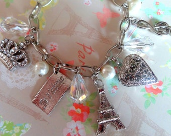 Going to Paris. Eiffel Tower, Heart, Je T'aime, Jeweled Crown, Music Charms Bracelet. Rhodium Plated.