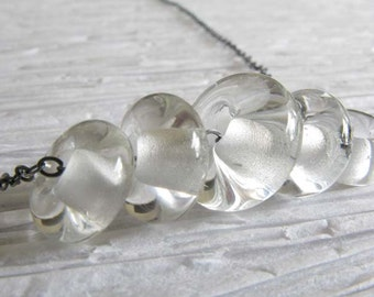 Clear glass bead necklace.  Long 24 inch oxidized sterling silver chain. Mini lampwork boro glass charms. Simple classic jewelry for her