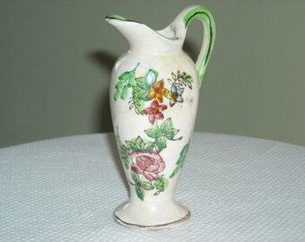 Small ceramic ewer / pitcher with floral design