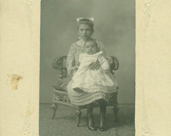 Edith & Evelyn Big Sister Holding Baby Wicker Chair Studio Portrait Cabinet Card Antique Black and White Photo Photograph