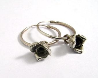 1.7 cm diameter Silver hoop earring with silver flower pendant