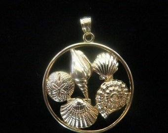 Gold plated sterling silver round pendant with seashells