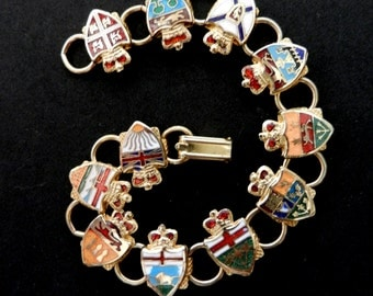 Vintage 1960 - Pretty golden brass and multi-coloured enamelled shield link bracelet. -Art.60/3 -