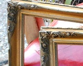 Pair of antique gold French style Louis XV picture frames