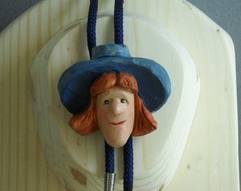 Bolo Tie with hand carved Cowgirl caricature slide.